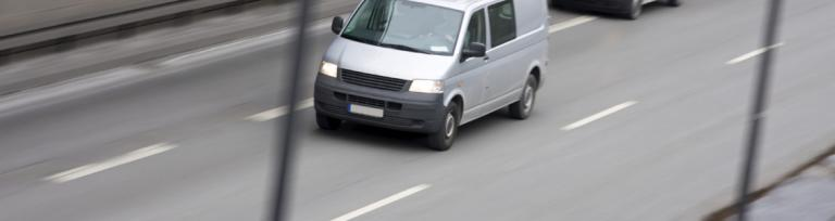 image of van driver on the road transporting freight