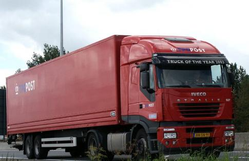 iveco articulated lorry on the road transporting freight